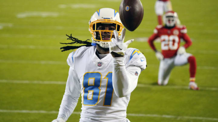 Jan 3, 2021; Kansas City, Missouri, USA; Los Angeles Chargers wide receiver Mike Williams (81) reacts after catching a pass for a touchdown against Kansas City Chiefs cornerback Antonio Hamilton (20) during the second half at Arrowhead Stadium. Mandatory Credit: Jay Biggerstaff-USA TODAY Sports