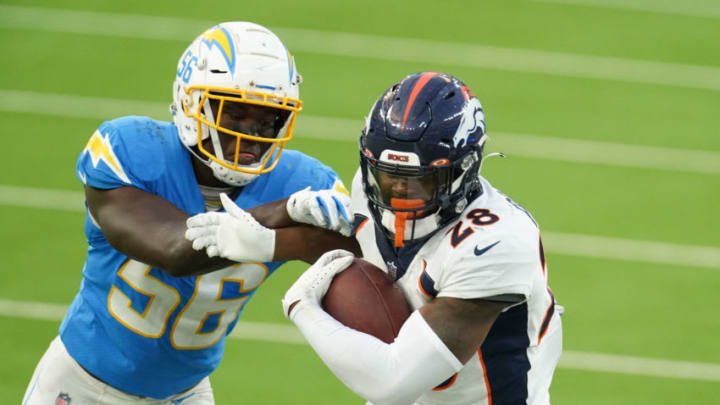 Dec 27, 2020; Inglewood, California, USA; Denver Broncos running back Royce Freeman (28) is defended by Los Angeles Chargers outside linebacker Kenneth Murray (56) in the fourth quarter at SoFi Stadium. Mandatory Credit: Kirby Lee-USA TODAY Sports