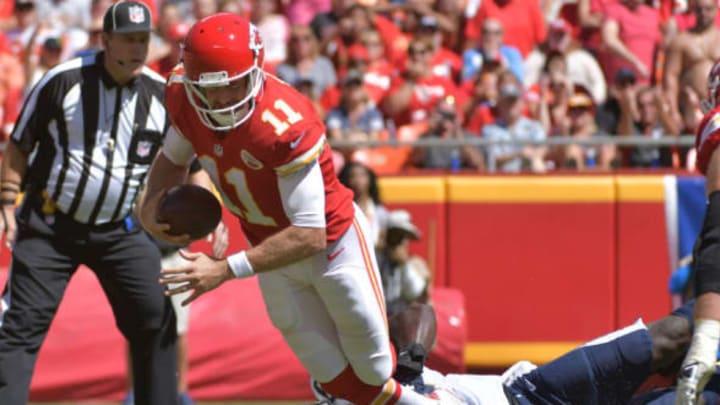Sep 11, 2016; Kansas City, MO, USA; Kansas City Chiefs quarterback Alex Smith (11) is sacked by San Diego Chargers linebacker Jerry Attaochu (97) during the first half at Arrowhead Stadium. Mandatory Credit: Denny Medley-USA TODAY Sports