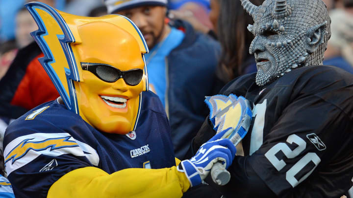 Dec 18, 2016; San Diego, CA, USA; A San Diego Chargers fan and an Oakland Raiders fan oppose each other in the stands during the fourth quarter at Qualcomm Stadium. Mandatory Credit: Jake Roth-USA TODAY Sports