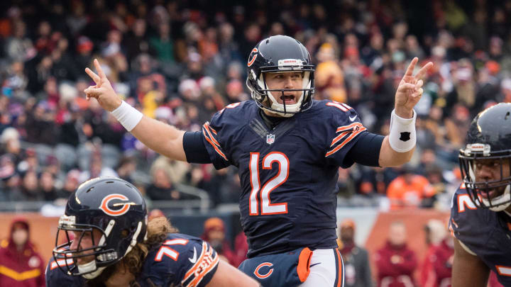 Dec 24, 2016; Chicago, IL, USA; Chicago Bears offensive tackle Josh Sitton (71) and quarterback Matt Barkley (12) in action during the game against the Washington Redskins at Soldier Field. The Redskins defeat the Bears 41-21. Mandatory Credit: Jerome Miron-USA TODAY Sports