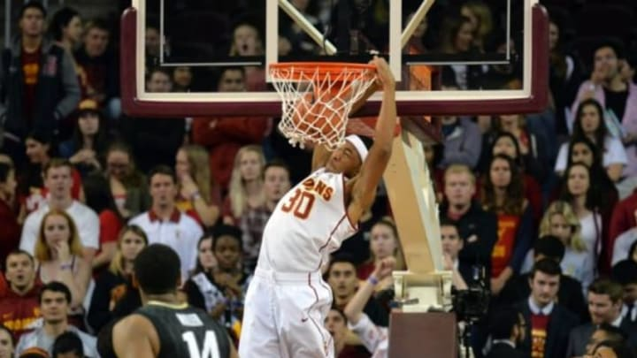 Feb 17, 2016; Los Angeles, CA, USA; Southern California Trojans guard Elijah Stewart (30) dunks the ball against the Colorado Buffaloes in an NCAA basketball game at Galen Center. Mandatory Credit: Kirby Lee-USA TODAY Sports