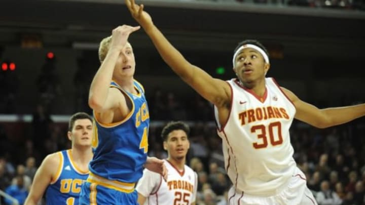 February 4, 2016; Los Angeles, CA, USA; Southern California Trojans guard Elijah Stewart (30) grabs a rebound against UCLA Bruins center Thomas Welsh (40) during the second half at Galen Center. Mandatory Credit: Gary A. Vasquez-USA TODAY Sports