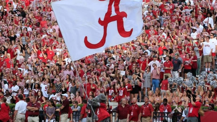 Sep 26, 2015; Tuscaloosa, AL, USA; Alabama Crimson Tide mascot Big Al waves the flag after a score at Bryant-Denny Stadium against the UL Monroe Warhawks. The Tide defeated the Warhawks 34-0. Mandatory Credit: Marvin Gentry-USA TODAY Sports