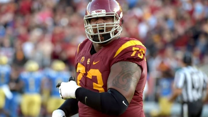 Nov 28, 2015; Los Angeles, CA, USA; Southern California Trojans offensive tackle Zach Banner (73) celebrates during an NCAA football game against the UCLA Bruins at Los Angeles Memorial Coliseum. Mandatory Credit: Kirby Lee-USA TODAY Sports
