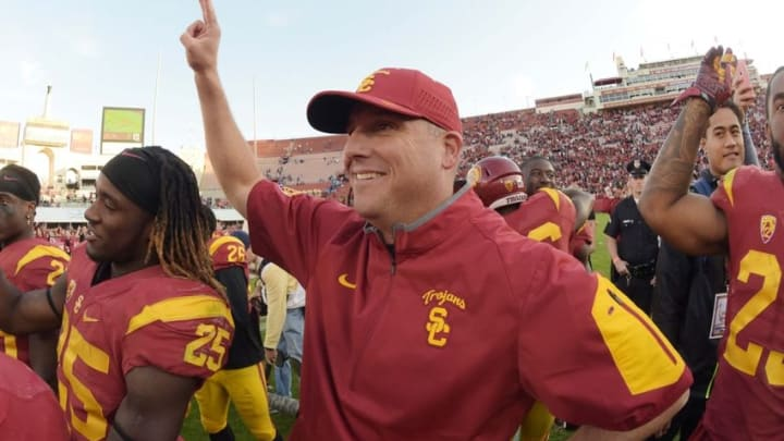 Nov 28, 2015; Los Angeles, CA, USA; Southern California Trojans head coach Clay Helton celebrates after an NCAA football game against the UCLA Bruins at Los Angeles Memorial Coliseum. USC defeated UCLA 40-21. Mandatory Credit: Kirby Lee-USA TODAY Sports
