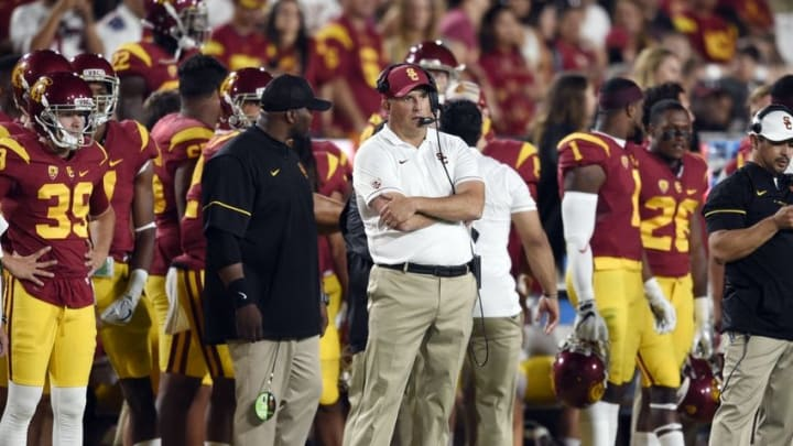 Oct 1, 2016; Los Angeles, CA, USA; Southern California Trojans head coach Clay Helton (center) stands on the sidelines during the second half against the Arizona State Sun Devils at Los Angeles Memorial Coliseum. Mandatory Credit: Kelvin Kuo-USA TODAY Sports