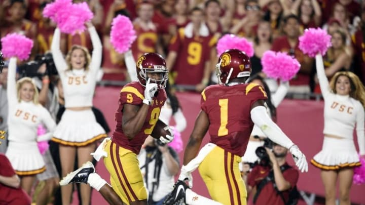 Oct 1, 2016; Los Angeles, CA, USA; Southern California Trojans wide receiver JuJu Smith-Schuster (9) looks at wide receiver Darreus Rogers (1) as he runs in a pass for a touchdown during the second half against the Arizona State Sun Devils at Los Angeles Memorial Coliseum. Mandatory Credit: Kelvin Kuo-USA TODAY Sports