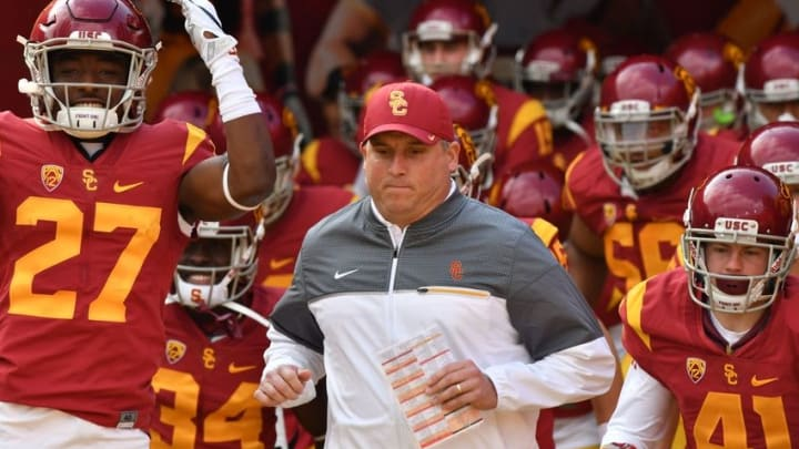 Nov 26, 2016; Los Angeles, CA, USA; USC Trojans head coach Clay Helton leads his players onto the field for the game against the Notre Dame Fighting Irish at the Los Angeles Memorial Coliseum. Mandatory Credit: Matt Cashore-USA TODAY Sports