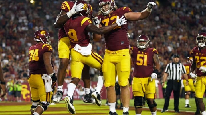 Oct 1, 2016; Los Angeles, CA, USA; Southern California Trojans wide receiver JuJu Smith-Schuster (9) celebrates his touchdown with offensive tackle Chad Wheeler (72) and offensive tackle Chuma Edoga (back) during the first half against the Arizona State Sun Devils at Los Angeles Memorial Coliseum. Mandatory Credit: Kelvin Kuo-USA TODAY Sports