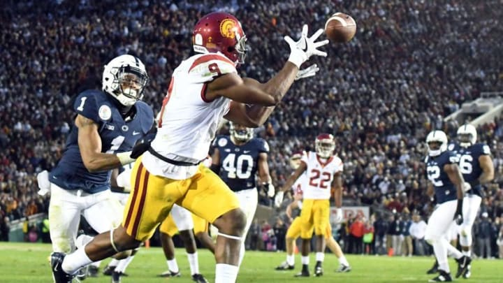 Jan 2, 2017; Pasadena, CA, USA; USC Trojans wide receiver JuJu Smith-Schuster (9) makes a catch for a touchdown against Penn State Nittany Lions cornerback Christian Campbell (1) during the third quarter of the 2017 Rose Bowl game at Rose Bowl. Mandatory Credit: Jayne Kamin-Oncea-USA TODAY Sports