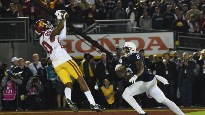 Jan 2, 2017; Pasadena, CA, USA; USC Trojans wide receiver Deontay Burnett (80) makes a catch for a touchdown against Penn State Nittany Lions safety Marcus Allen (2) during the fourth quarter of the 2017 Rose Bowl game at Rose Bowl. Mandatory Credit: Jayne Kamin-Oncea-USA TODAY Sports