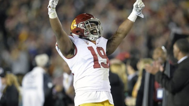 January 2, 2017; Pasadena, CA, USA; Southern California Trojans linebacker Michael Hutchings (19) reacts after defensive back Leon McQuay III (22) intercepts a pass against the Penn State Nittany Lions during the second half of the 2017 Rose Bowl game at the Rose Bowl. Mandatory Credit: Gary A. Vasquez-USA TODAY Sports