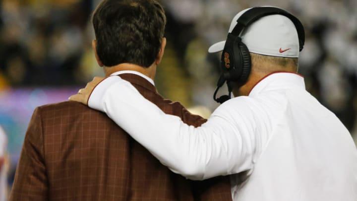 USC football head coach Clay Helton and AD Mike Bohn. (Alicia de Artola/Reign of Troy)