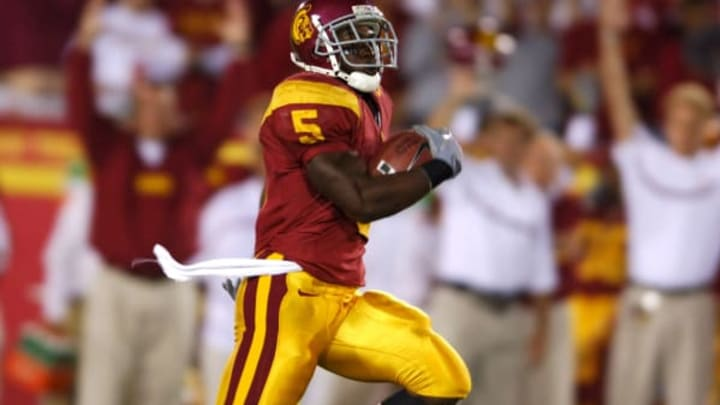 USC junior tailback Reggie Bush scores on a 76-yard run in the first quarter of 70-17 victory over Arkansas at the Los Angeles Memorial Coliseum on Saturday, Sept. 17, 2005. (Photo by Kirby Lee/Getty Images)