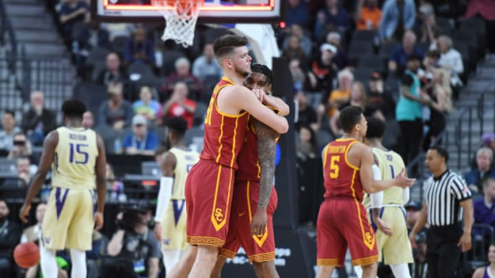 LAS VEGAS, NEVADA - MARCH 14: Nick Rakocevic (L) #31 of the USC Trojans hugs teammate Kevin Porter Jr. #4 after he hit a 3-pointer against the Washington Huskies at the end of the first half of a quarterfinal game of the Pac-12 basketball tournament at T-Mobile Arena on March 14, 2019 in Las Vegas, Nevada. (Photo by Ethan Miller/Getty Images)