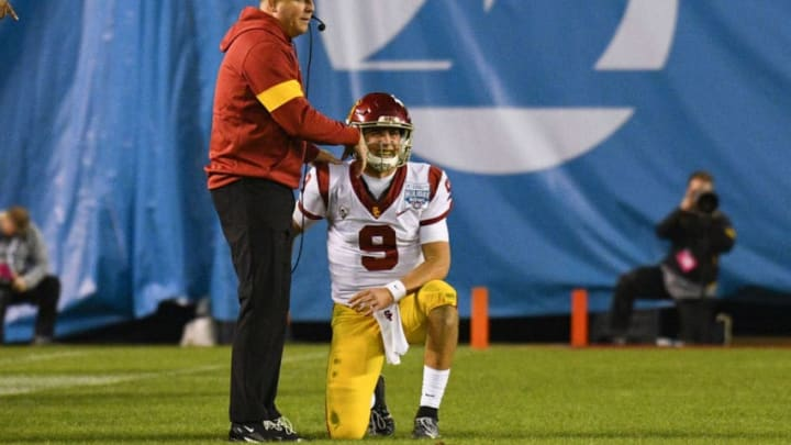 SAN DIEGO, CA - DECEMBER 27: USC Trojans head coach Clay Helton points down to USC Trojans quarterback Kedon Slovis (9), who was hurt on the play, during the San Diego County Credit Union Holiday Bowl football game between the USC Trojans and the Iowa Hawkeyes on December 27, 2019 at SDCCU Stadium in San Diego, California. (Photo by Brian Rothmuller/Icon Sportswire via Getty Images)