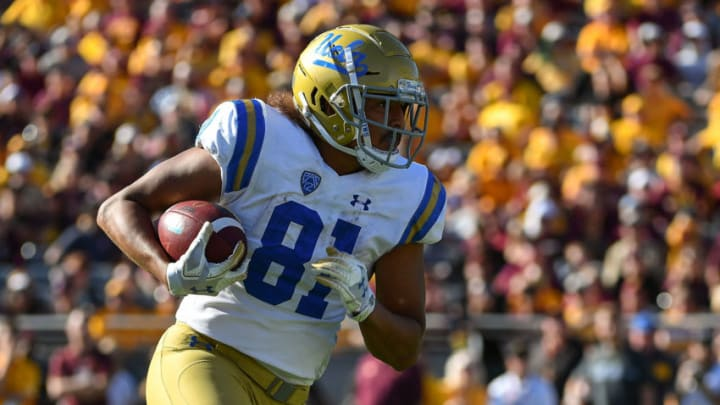 TEMPE, AZ - NOVEMBER 10: Tight end Caleb Wilson #81 of the UCLA Bruins carries the football for a 33 yard touchdown in the second half against the Arizona State Sun Devils at Sun Devil Stadium on November 10, 2018 in Tempe, Arizona. The Arizona State Sun Devils won 31-28. (Photo by Jennifer Stewart/Getty Images)