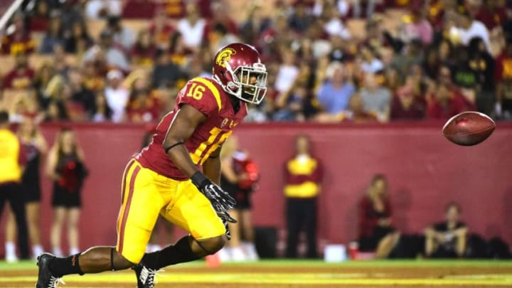 LOS ANGELES, CA - SEPTEMBER 05: Dominic Davis #16 of the USC Trojans mis-handles a kickoff during the third quarter against the Arkansas State Red Wolves at Los Angeles Coliseum on September 5, 2015 in Los Angeles, California. (Photo by Harry How/Getty Images)