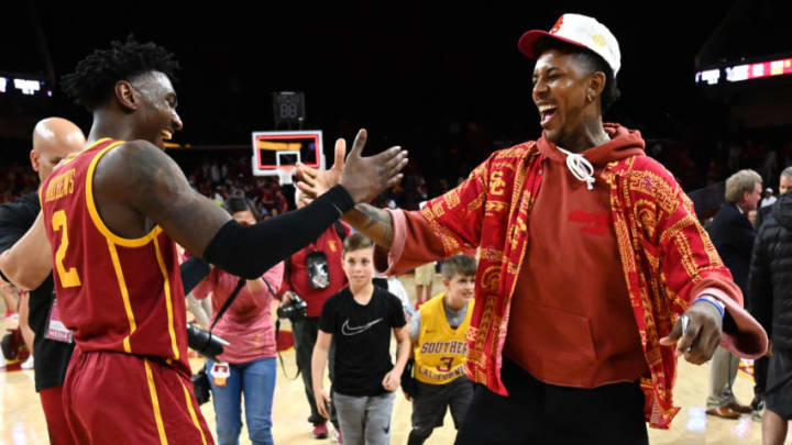 LOS ANGELES, CA - MARCH 07: Former USC and NBA player Nick Young celebrates with Jonah Mathews #2 of the USC Trojans after defeating the UCLA Bruins at Galen Center on March 7, 2020 in Los Angeles, California. (Photo by Jayne Kamin-Oncea/Getty Images)