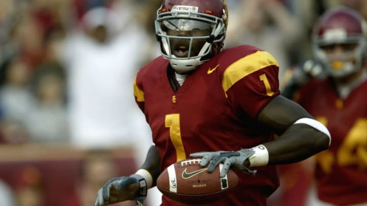 LOS ANGELES - DECEMBER 6: Wide receiver Mike Williams #1 of the USC Trojans celebrates a touchdown reception against the Oregon State Beavers on December 6, 2003 at the Los Angeles Coliseum in Los Angeles, California. (Photo by Stephen Dunn/Getty Images)