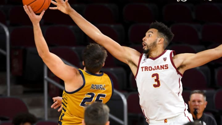 Nov 25, 2020; Los Angeles, California, USA; USC Trojans forward Isaiah Mobley (3) blocks a shot by California Baptist Lancers guard Ty Rowell (25) in the second half at the Galen Center. Mandatory Credit: Jayne Kamin-Oncea-USA TODAY Sports