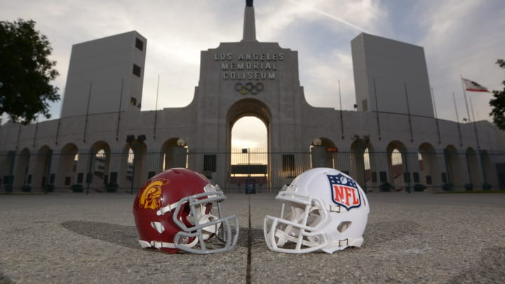 Mar 4, 2016; Los Angeles, CA, USA; General view of the football helmet of the Southern California Trojans and the shield logo helmet of the NFL and the Olympic torch at the peristyle end of the Los Angeles Memorial Coliseum. The Coliseum operated by USC will serve as the temporary home of the Los Angeles Rams after NFL owners voted 30-2 to allow Rams owner Stan Kroenke (not pictured) to relocate the franchise from St. Louis for the 2016 season. Mandatory Credit: Kirby Lee-USA TODAY Sports