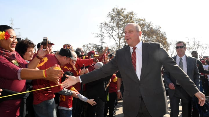 Nov 26, 2016; Los Angeles, CA, USA; Southern California Trojans head coach Clay Helton greets fans during the Trojan Walk before a NCAA football game against the Notre Dame Fighting Irish at Los Angeles Memorial Coliseum. Mandatory Credit: Kirby Lee-USA TODAY Sports