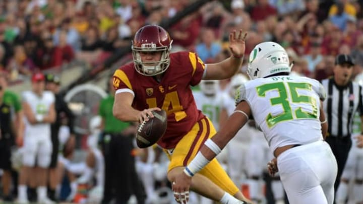 Nov 5, 2016; Los Angeles, CA, USA; Southern California Trojans quarterback Sam Darnold (14) is pressured by Oregon Ducks linebacker Troy Dye (35) during a NCAA football game at Los Angeles Memorial Coliseum. Mandatory Credit: Kirby Lee-USA TODAY Sports