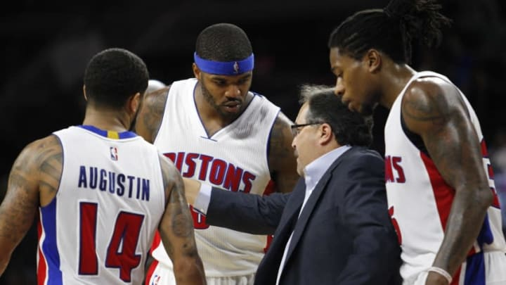 Oct 23, 2014; Auburn Hills, MI, USA; Detroit Pistons head coach Stan Van Gundy gives instructions to guard D.J. Augustin (14) and forward Josh Smith (6) and forward Cartier Martin (35) during the fourth quarter against the Philadelphia 76ers at The Palace of Auburn Hills. Pistons beat the Sixers 109-103. Mandatory Credit: Raj Mehta-USA TODAY Sports