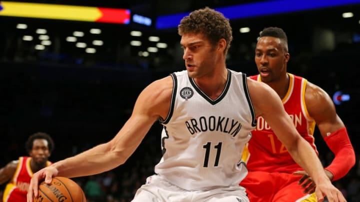 Jan 12, 2015; Brooklyn, NY, USA; Brooklyn Nets center Brook Lopez (11) controls the ball defended by Houston Rockets center Dwight Howard (12) during the third quarter at the Barclays Center. The Rockets defeated the Nets 113-99. Mandatory Credit: Adam Hunger-USA TODAY Sports