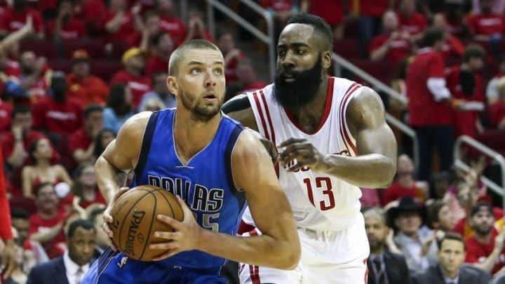 Apr 18, 2015; Houston, TX, USA; Dallas Mavericks forward Chandler Parsons (25) drives the ball during the third quarter as Houston Rockets guard James Harden (13) defends in game one of the first round of the NBA Playoffs at Toyota Center. Mandatory Credit: Troy Taormina-USA TODAY Sports