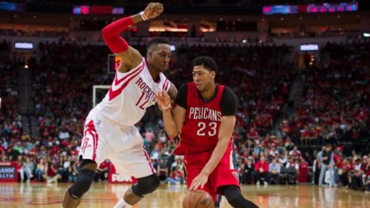 Apr 12, 2015; Houston, TX, USA; Houston Rockets center Dwight Howard (12) defends against New Orleans Pelicans forward Anthony Davis (23) during the second quarter at the Toyota Center. Mandatory Credit: Jerome Miron-USA TODAY Sports