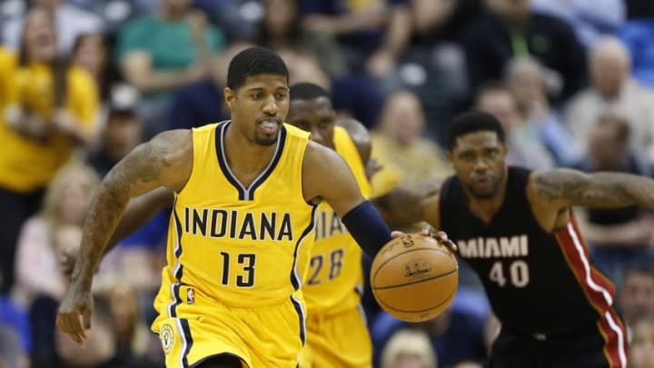 Apr 5, 2015; Indianapolis, IN, USA; Indiana Pacers forward Paul George (13) leads a fast break against the Miami Heat at Bankers Life Fieldhouse. Indiana defeats Miami 112-89. Mandatory Credit: Brian Spurlock-USA TODAY Sports