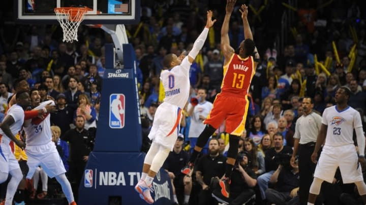 Apr 5, 2015; Oklahoma City, OK, USA; Houston Rockets guard James Harden (13) shoots the ball as Oklahoma City Thunder guard Russell Westbrook (0) defends during the fourth quarter at Chesapeake Energy Arena. Mandatory Credit: Mark D. Smith-USA TODAY Sports