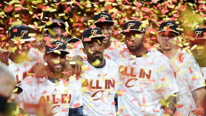 May 26, 2015; Cleveland, OH, USA; Cleveland Cavaliers guard Kyrie Irving (2), guard J.R. Smith (5) and forward LeBron James (23) celebrates beating the Atlanta Hawks in game four of the Eastern Conference Finals of the NBA Playoffs at Quicken Loans Arena. Mandatory Credit: Ken Blaze-USA TODAY Sports