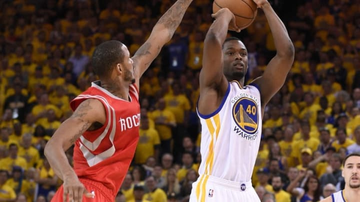May 27, 2015; Oakland, CA, USA; Golden State Warriors forward Harrison Barnes (40) shoots over Houston Rockets forward Trevor Ariza (1) during the fourth quarter in game five of the Western Conference Finals of the NBA Playoffs. at Oracle Arena. Mandatory Credit: Kyle Terada-USA TODAY Sports