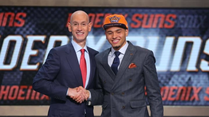 Jun 26, 2014; Brooklyn, NY, USA; Tyler Ennis (Syracuse) shakes hands with NBA commissioner Adam Silver after being selected as the number eighteen overall pick to the Phoenix Suns in the 2014 NBA Draft at the Barclays Center. Mandatory Credit: Brad Penner-USA TODAY Sports