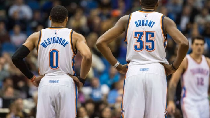 Dec 12, 2014; Minneapolis, MN, USA; Oklahoma City Thunder guard Russell Westbrook (0) and forward Kevin Durant (35) look on against the Minnesota Timberwolves at Target Center. The Thunder defeated the Timberwolves 111-92. Mandatory Credit: Brace Hemmelgarn-USA TODAY Sports