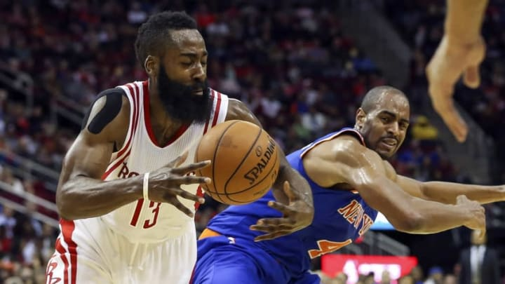 Nov 21, 2015; Houston, TX, USA; Houston Rockets guard James Harden (13) attempts to steal the ball from New York Knicks guard Arron Afflalo (4) during the third quarter at Toyota Center. Mandatory Credit: Troy Taormina-USA TODAY Sports
