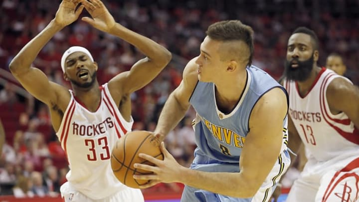 Oct 28, 2015; Houston, TX, USA; Denver Nuggets forward Danilo Gallinari (8) defends the ball from Houston Rockets guard James Harden (13) in the second half on opening night at Toyota Center. Denver won 105 to 85. Mandatory Credit: Thomas B. Shea-USA TODAY Sports