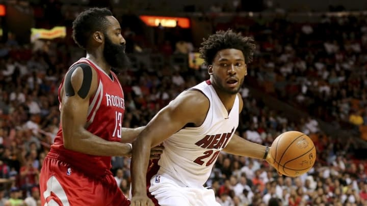 Nov 1, 2015; Miami, FL, USA; Miami Heat forward Justise Winslow (20) is pressured by Houston Rockets guard James Harden (13) during the second half at American Airlines Arena. The Heat won 109-89. Mandatory Credit: Steve Mitchell-USA TODAY Sports