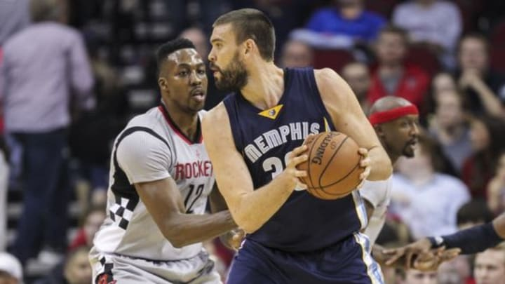 Nov 25, 2015; Houston, TX, USA; Memphis Grizzlies center Marc Gasol (33) controls the ball as Houston Rockets center Dwight Howard (12) defends during the first quarter at Toyota Center. Mandatory Credit: Troy Taormina-USA TODAY Sports