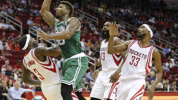 Nov 16, 2015; Houston, TX, USA; Boston Celtics guard Marcus Smart (36) shoots against Houston Rockets guard Ty Lawson (3) while guard James Harden (13) and guard Corey Brewer (33) follow in the second quarter at Toyota Center. Mandatory Credit: Thomas B. Shea-USA TODAY Sports