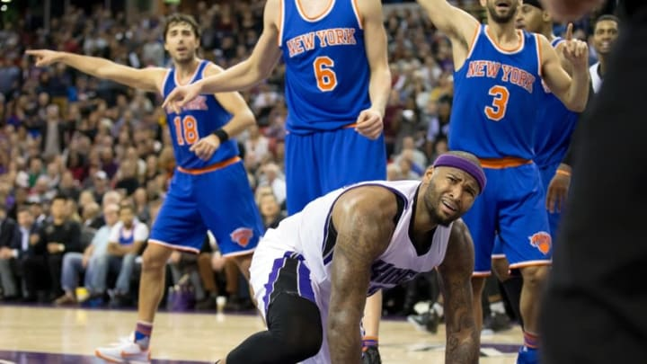 Dec 10, 2015; Sacramento, CA, USA; Sacramento Kings forward DeMarcus Cousins (15) reacts after being called for traveling against the New York Knicks during the fourth quarter at Sleep Train Arena. The Sacramento Kings defeated the New York Knicks 99-97. Mandatory Credit: Kelley L Cox-USA TODAY Sports