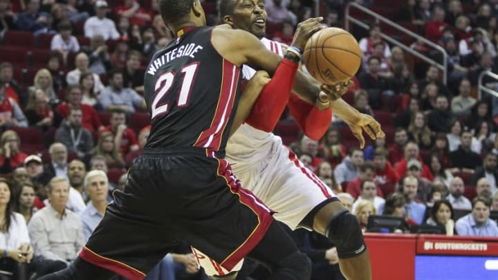 Jan 3, 2015; Houston, TX, USA; Houston Rockets center Dwight Howard (12) attempts to drive the ball around Miami Heat center Hassan Whiteside (21) during the second quarter at Toyota Center. Mandatory Credit: Troy Taormina-USA TODAY Sports