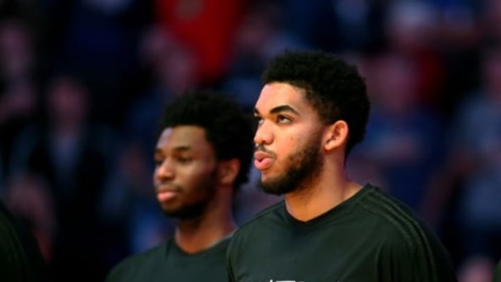 Dec 13, 2015; Phoenix, AZ, USA; Minnesota Timberwolves center Karl-Anthony Towns (right) and guard Andrew Wiggins against the Phoenix Suns at Talking Stick Resort Arena. The Suns defeated the Timberwolves 108-101. Mandatory Credit: Mark J. Rebilas-USA TODAY Sports
