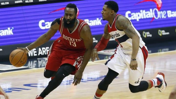 Dec 9, 2015; Washington, DC, USA; Houston Rockets guard James Harden (13) dribbles the ball as Washington Wizards guard Bradley Beal (3) defends in the third quarter at Verizon Center. The Rockets won 109-103. Mandatory Credit: Geoff Burke-USA TODAY Sports