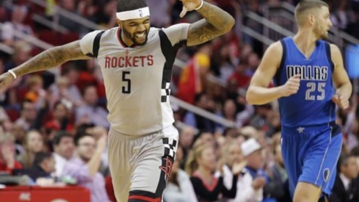 Jan 24, 2016; Houston, TX, USA; Houston Rockets center Josh Smith (5) reacts after making a three point basket against the Dallas Mavericks forward Chandler Parsons (25) in the second half at Toyota Center. Rockets won 115 to 104. Mandatory Credit: Thomas B. Shea-USA TODAY Sports