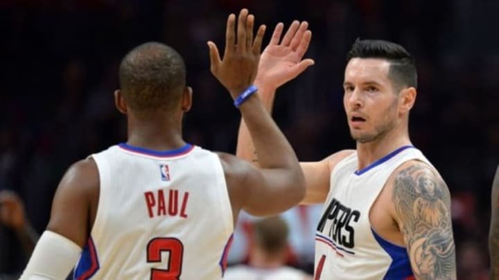 Jan 18, 2016; Los Angeles, CA, USA; Los Angeles Clippers guard Chris Paul (3) and guard J.J. Redick (4) celebrate during an NBA basketball game against the Houston Rockets at Staples Center. Mandatory Credit: Kirby Lee-USA TODAY Sports